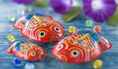 13805588(金魚のブリキ玩具)とその連想画像
